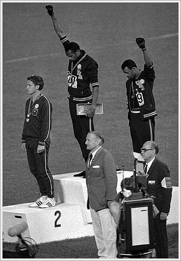 Tommie Smith and John Carlos give the Black Power salute