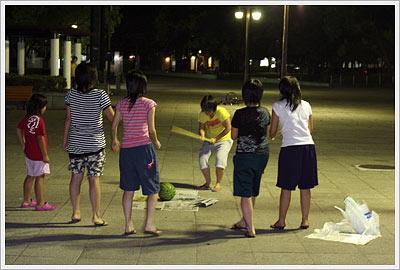 Young women doing suika-wari